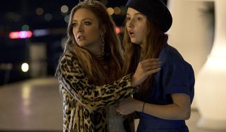 "This image released by Annapurna Pictures shows Billie Lourd, left, and Kaitlyn Dever in a scene from the film ""Booksmart,"" directed by Olivia Wilde. (Francois Duhamel/Annapurna Pictures via AP)"