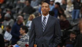 FILE - In this Jan. 19, 2016 file photo, then-Oklahoma City Thunder assistant coach Monty Williams watches during the second half of an NBA basketball game in Denver. The Phoenix Suns announced Friday, May 3, 2019, they have hired Williams as their new coach, replacing Igor Kokoskov, who was fired last week after one disappointing season.  (AP Photo/David Zalubowski, File)