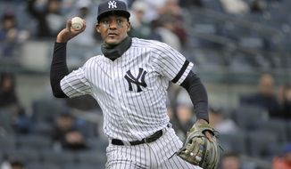 FILE - In this March 31, 2019, file photo, New York Yankees' Miguel Andujar throws to first base during the second inning of the team's baseball game against the Baltimore Orioles at Yankee Stadium in New York. Andújar is set to come off the injured list Saturday, and the team hopes infielder DJ LeMahieu will return to the lineup that day as well. Yankees outfielder Clint Frazier is scheduled to follow on Monday, when center fielder Aaron Hicks could begin a minor league rehab assignment. With 13 players still on the injured list, manager Aaron Boone gave a long rundown of medical status reports Friday, May 3, before New York opened a homestand against the major league-leading Minnesota Twins. (AP Photo/Seth Wenig, File)