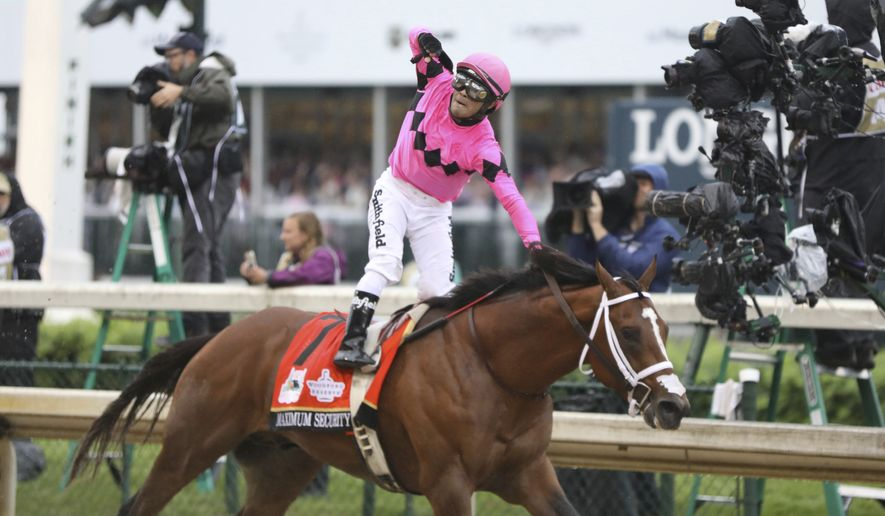 Luis Saez rides Maximum Security, and celebrates after crossing the finish line first during the 145th running of the Kentucky Derby horse race at Churchill Downs Saturday, May 4, 2019, in Louisville, Ky. Country House was declared the winner after Maximum Security was disqualified following a review by race stewards. (AP Photo/Gregory Payan) ** FILE **
