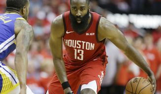 Houston Rockets guard James Harden (13) dribbles as Golden State Warriors guard Andre Iguodala defends during the second half of Game 3 of a second-round NBA basketball playoff series, Saturday, May 4, 2019, in Houston. (AP Photo/Eric Christian Smith) ** FILE **