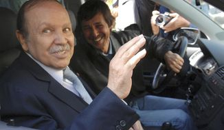 FILE - This Friday April 10, 2009 file photo shows Algerian President Abdelaziz Bouteflika, left, and his brother Said Bouteflika arrives at his campaign headquarters in the Hydra district of Algiers, a day after the Algerian presidential election. The influential younger brother of Algeria's former longtime president was detained Saturday May 4, 2019, for questioning along with two generals who previously ran state security agencies, a security official said. (AP Photo, File)