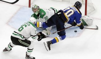 Dallas Stars goaltender Ben Bishop (30) blocks a shot by St. Louis Blues center Oskar Sundqvist (70), of Sweden, during the third period in Game 5 of an NHL second-round hockey playoff series Friday, May 3, 2019, in St. Louis. Also defending for the Stars is Jason Dickinson (16). The Stars won 2-1 and lead the series 3-2. (AP Photo/Jeff Roberson)