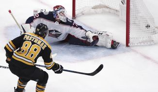 Boston Bruins right wing David Pastrnak (88) beats Columbus Blue Jackets goaltender Sergei Bobrovsky for a his second goal of an NHL hockey game during the third period of Game 5 of a second-round playoff series, Saturday, May 4, 2019, in Boston. (AP Photo/Charles Krupa)