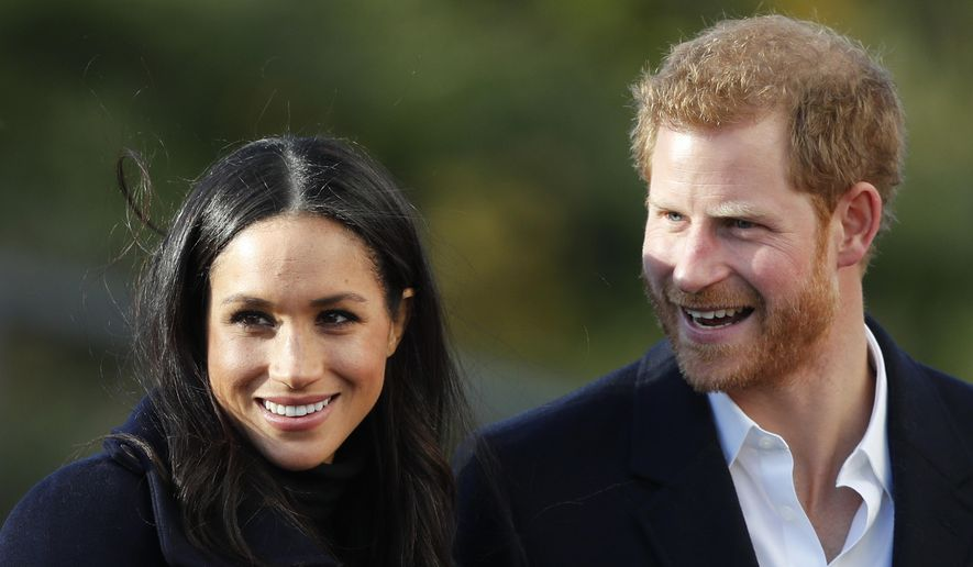 In this Dec. 1, 2017, file photo, Britain's Prince Harry and his fiancee Meghan Markle arrive at Nottingham Academy in Nottingham, England. (AP Photo/Frank Augstein, File)