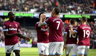 West Ham United's Marko Arnautovic, center, celebrates scoring his side's second goal of the game during their English Premier League soccer match against Southampton at London Stadium in London, Saturday, May 4, 2019. (Victoria Jones/PA via AP)