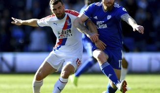 Cardiff City's Aron Gunnarsson, right, and Crystal Palace's James McArthur battle for the ball during their English Premier League soccer match at Cardiff City Stadium, Cardiff, Wales, Saturday May 4, 2019. (Simon Galloway/PA via AP)