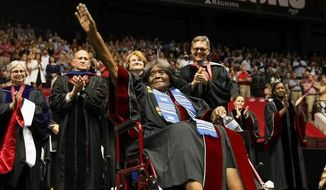 This photo provided by UA Strategic Communications Autherine Lucy Foster acknowledges the crowd as she receives a an honorary doctoral degree during a commencement exercise at The University of Alabama on Friday, May 3, 2019 in Tuscaloosa, Ala.  The university bestowed the honorary doctorate degree to Foster, the first African American to attend the university.  (Zach Riggins/UA Strategic Communications via AP)