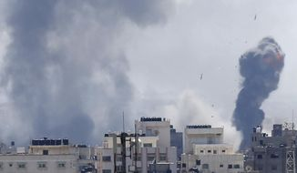 Israeli airstrikes hit Gaza City, Saturday, May 4, 2019. Palestinian militants in the Gaza Strip fired at least 90 rockets into southern Israel on Saturday, according to the Israeli military, triggering retaliatory airstrikes and tank fire against militant targets in the blockaded enclave and shattering a month-long lull in violence. (AP Photo/Hatem Moussa)