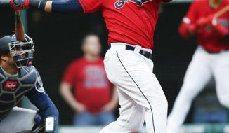 Cleveland Indians' Carlos Santana hits a two-run home run off Seattle Mariners relief pitcher Connor Sadzeck during the eighth inning of a baseball game, Saturday, May 4, 2019, in Cleveland. The Indians defeated the Mariners 5-4. (AP Photo/Ron Schwane)