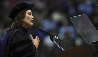 """After Michigan Gov. Gretchen Whitmer joked about not mentioning her campaign slogan on fixing roads, Gov. Gretchen Whitmer gave these four pieces of advice to Michigan State University graduates Friday, May 3, 2019, at the Breslin Center: """"Build bridges - don't live under them, look for inspiration in unusual places, wear fun socks, and do not read the comments section,"""" she said. Whitmer, a Spartan alumnus has a bachelor's degree in communications and a juris doctor degree from MSU. She was awarded an honor degree of Doctor of Laws Friday afternoon. (Matthew Dae Smith/Lansing State Journal via AP)"""