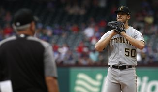 Pittsburgh Pirates starting pitcher Jameson Taillon reacts as manager Clint Hurdle walks to the mound to relieve him against the Texas Rangers during the seventh inning of a baseball game Wednesday May 1, 2019, in Arlington, Texas. (AP Photo/Mike Stone)