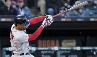 Boston Red Sox's Xander Bogaerts hits a two-run home run against the Chicago White Sox during the third inning of a baseball game in Chicago, Saturday, May 4, 2019. (AP Photo/Nam Y. Huh)