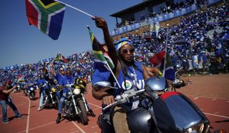 Democratic Alliance supporters on motorcycles cheer their leader Mmusi Maimane as he arrives at the Dobsonville Stadium in Johannesburg, South Africa, Saturday May 4, 2019, ahead of South Africa's election on May 8. (AP Photo/Jerome Delay)