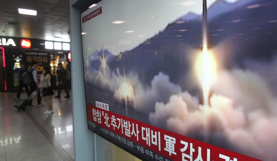 """A TV screen shows a file footage of North Korea's missile launch during a news program at the Seoul Railway Station in Seoul, South Korea, Saturday, May 4, 2019.  North Korea on Saturday fired several unidentified short-range projectiles into the sea off its eastern coast, the South Korean Joint Chiefs of Staff said, a likely sign of Pyongyang's growing frustration at stalled diplomatic talks with Washington meant to provide coveted sanctions relief in return for nuclear disarmament. The signs read: """"Strengthening military alertness."""" (AP Photo/Ahn Young-joon)"""