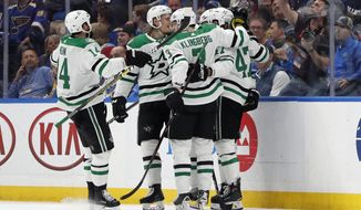 Dallas Stars players Jamie Benn (14), John Klingberg (3), of Sweden, and Alexander Radulov (47), of Russia, celebrate after a goal by Esa Lindell against the St. Louis Blues during the second period in Game 5 of an NHL second-round hockey playoff series Friday, May 3, 2019, in St. Louis. (AP Photo/Jeff Roberson)