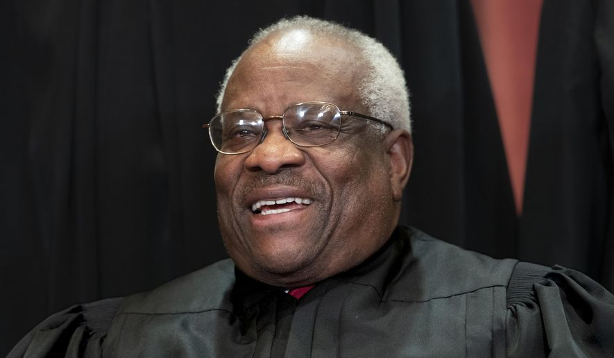 In this Nov. 30, 2018, file photo, Supreme Court Associate Justice Clarence Thomas, appointed by President George H. W. Bush, sits with fellow Supreme Court justices for a group portrait at the Supreme Court Building in Washington. Thomas is now the longest-serving member of a court that has recently gotten more conservative, putting him in a unique and potentially powerful position, and he's said he isn't going away anytime soon. With President Donald Trump's nominees Neil Gorsuch and Brett Kavanaugh now on the court, conservatives are firmly in control as the justices take on divisive issues such as abortion, gun control and LGBT rights. (AP Photo/J. Scott Applewhite, File)