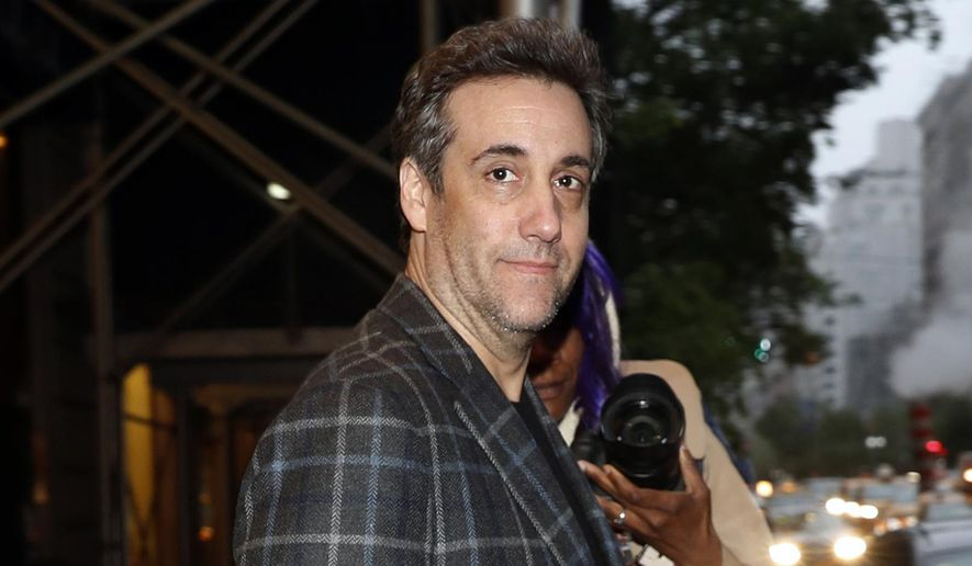 Michael Cohen, Donald Trump's former personal attorney, leaves his apartment, Friday, May 3, 2019, in New York. Cohen is scheduled to report to the Otisville Federal Correctional Facility in upstate New York on Monday to begin serving his three year prison term for tax evasion, lying to Congress and campaign finance crimes. (AP Photo/Kathy Willens)