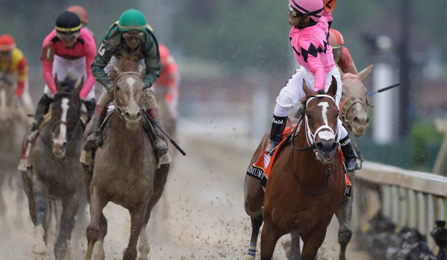 Maximum Security appeared to have won the 145th Kentucky Derby on Saturday in Louisville, Kentucky, however, the horse was disqualified for interference. (Associated Press)
