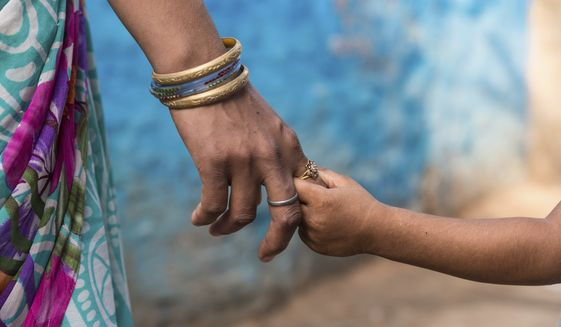 Although you may not always see the evidence, your words will echo across the years in the hearts and minds of your children and perhaps to generations yet unborn. Choose them carefully, share them lovingly, Rebecca Hagelin writes. (AP Photo/Rajesh Kumar Singh) **FILE**