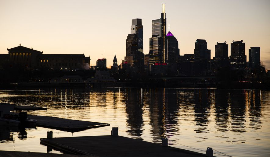The skyline is reflected in the Schuylkill River as the sun rises over Philadelphia, Thursday, Feb. 14, 2019. (AP Photo/Matt Rourke)