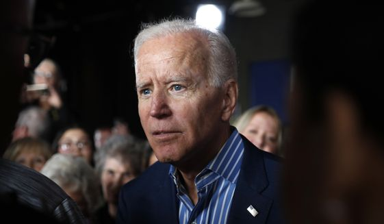 In this May 1, 2019, file photo, former Vice President and Democratic presidential candidate Joe Biden greets audience members during a rally in Iowa City, Iowa. (AP Photo/Charlie Neibergall) ** FILE **