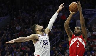 Toronto Raptors' Kawhi Leonard, right, shoots as Philadelphia 76ers' Ben Simmons, left, defends during the second half of Game 4 of a second-round NBA basketball playoff series, Sunday, May 5, 2019, in Philadelphia. (AP Photo/Chris Szagola)