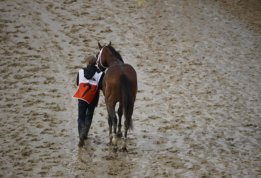 Maximum Security is walked off the track after being disqualified for the 145th running of the Kentucky Derby horse race at Churchill Downs Saturday, May 4, 2019, in Louisville, Ky. (AP Photo/Charlie Riedel) **FILE**