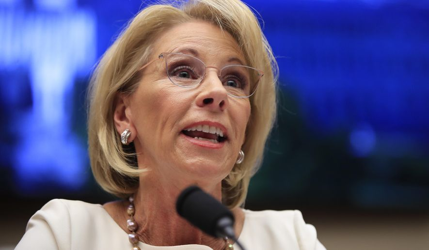 Education Secretary Betsy DeVos testifies before the House Education and Labor Committee at a hearing on 'Examining the Policies and Priorities of the U.S. Department of Education' on Capitol Hill in Washington, April 10, 2019. (AP Photo/Manuel Balce Ceneta) ** FILE **