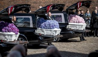 The funeral service for the three children of the CEO of clothing brand Bestseller, Anders Holch Povlsen and wife Anne, at Aarhus Cathedral, Denmark, Saturday May 4, 2019, who were victims of the bombings in Sri Lanka on April 21. More than 350 people were killed in bombings of churches and hotels in Sri Lanka on Easter Sunday. (Mads Claus Rasmussen/Ritzau Scanpix via AP)