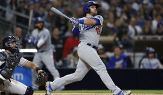 The Los Angeles Dodgers' Max Muncy watches his three-run home run during the sixth inning of the team's baseball game against the San Diego Padres, Saturday, May 4, 2019, in San Diego. (AP Photo/Gregory Bull)