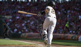 San Francisco Giants' Buster Posey watches his three-run home run in the sixth inning of a baseball game against the Cincinnati Reds, Sunday, May 5, 2019, in Cincinnati. (AP Photo/Aaron Doster)