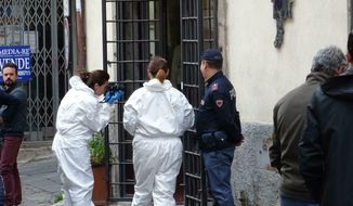 In this photo taken on Friday, May 3, 2019, forensic police officers inspect the shop where 74-year-old Norveo Fedeli was killed in Viterbo, Italy. Italian police have arrested a 22-year-old U.S. man and accused him of killing a 74-year-old Italian owner of a clothing store in Viterbo, a city near Rome. Police arrested Michael Aaron Pang on Saturday and allege that he killed the storekeeper by striking him with a stool. The body of Norveo Fedeli was found inside his store on Friday, Lt. Col. Guglielmo Trombetta told The Associated Press. (Moscatelli/ANSA via AP)