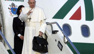 Pope Francis boards the airplane on the occasion of a three-day trip to Bulgaria and Macedonia at Rome's Fiumicino International airport, Sunday, May 5, 2019. (AP Photo/Gregorio Borgia)