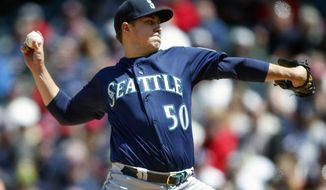 Seattle Mariners starting pitcher Erik Swanson delivers against the Cleveland Indians during the first inning of a baseball game, Sunday, May 5, 2019, in Cleveland. (AP Photo/Ron Schwane)