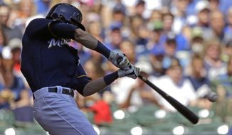 Milwaukee Brewers' Christian Yelich hits a two-run home run during the third inning of a baseball game against the New York Mets Sunday, May 5, 2019, in Milwaukee. (AP Photo/Aaron Gash)