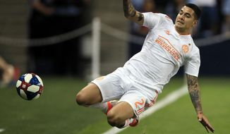 Atlanta United defender Franco Escobar (2) tries to keep the ball in bounds during the first half of an MLS soccer match against Sporting Kansas City in Kansas City, Kan., Sunday, May 5, 2019. (AP Photo/Orlin Wagner)