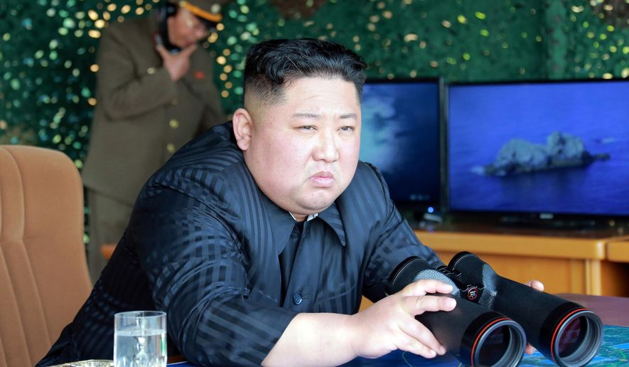 """This Saturday, May 4, 2019, photo provided on Sunday, May 5, 2019, by the North Korean government shows North Korean leader Kim Jong Un, equipped with binoculars, observing tests of different weapons systems, in North Korea. North Korean state media on Sunday said leader Kim observed live-fire drills of long-range multiple rocket launchers and unspecified tactical guided weapons, a day after South Korea's military detected the North launching several unidentified short-range projectiles into the sea off its eastern coast. Independent journalists were not given access to cover the event depicted in this image distributed by the North Korean government. The content of this image is as provided and cannot be independently verified. Korean language watermark on image as provided by source reads: """"KCNA"""" which is the abbreviation for Korean Central News Agency. (Korean Central News Agency/Korea News Service via AP)"""
