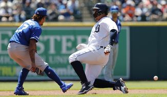 Detroit Tigers' Miguel Cabrera beats the throw to Kansas City Royals second baseman Adalberto Mondesi for a double during the first inning of a baseball game, Sunday, May 5, 2019, in Detroit. (AP Photo/Carlos Osorio)