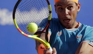 Spain's Rafael Nadal returns the ball to Austria's Dominic Thiem during their semifinal match at the Barcelona Open Tennis Tournament in Barcelona, Spain, Saturday, April 27, 2019. (AP Photo/Manu Fernandez)