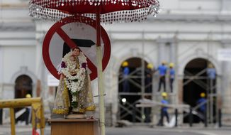A statute of St. Anthony is seen kept out side the exploded St. Anthony's church as naval soldiers carry out reconstruction work in Colombo, Sri Lanka, Friday, May 3, 2019. Catholic services are being canceled for a second weekend in Sri Lanka's capital after the government warned of more possible attacks by the same Islamic State-linked group that carried out Easter suicide bombings. (AP Photo/Eranga Jayawardena)