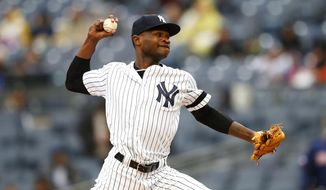 New York Yankees' starting pitcher Domingo German delivers against the Minnesota Twins in the first inning of a baseball game Sunday, May 5, 2019, in New York. (AP Photo/Noah K. Murray)