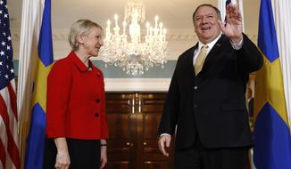 Secretary of State Mike Pompeo, right, waves as he stands alongside Swedish Foreign Minister Margot Wallstrom, Monday, April 29, 2019, at the U.S. State Department in Washington. (AP Photo/Patrick Semansky)