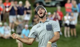 Max Homa celebrates after winning the Wells Fargo Championship golf tournament at Quail Hollow Club in Charlotte, N.C., Sunday, May 5, 2019. (AP Photo/Chuck Burton)