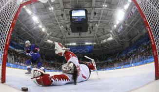 FILE - In this Feb. 22, 2018, file pool photo, United States' Jocelyne Lamoureux-Davidson (17) scores the game-winning goal past Canada goalie Shannon Szabados (1) during a penalty shootout in the women's gold medal hockey game at the 2018 Winter Olympics in Gangneung, South Korea. More than 200 of the world's top female players are choosing not to play professional hockey in North America at all this year in an attempt to establish a economically viable professional league. (Bruce Bennett/Pool Photo via AP, File)