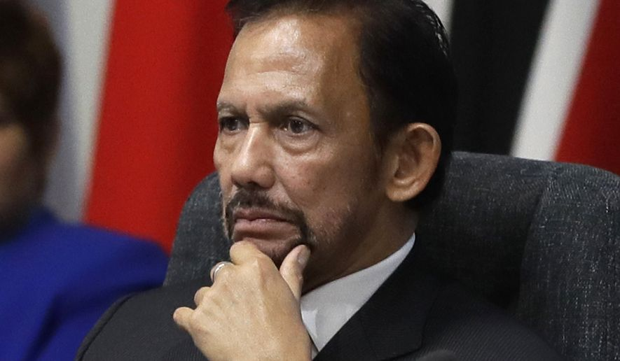 In this April 19, 2018, file photo, the Sultan of Brunei Hassanal Bolkiah listens during the first executive session of the CHOGM summit at Lancaster House in London. Brunei's sultan has said a moratorium on capital punishment is in effect for new Shariah criminal laws including stoning people for gay sex and adultery that sparked an international outcry. (AP Photo/Kirsty Wigglesworth, File)