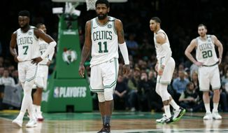 Boston Celtics' Kyrie Irving (11) and teammates, from left to right, Jaylen Brown, Marcus Morris, Jayson Tatum and Gordon Hayward wait for the ball to be put in play by the Milwaukee Bucks during the second half of Game 4 of a second-round NBA basketball playoff series in Boston, Monday, May 6, 2019. (AP Photo/Michael Dwyer)