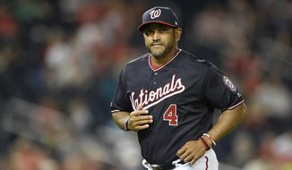 Washington Nationals manager Dave Martinez walks on the field during a baseball game against the St. Louis Cardinals, Tuesday, April 30, 2019, in Washington. The Cardinals won 3-2. (AP Photo/Nick Wass) ** FILE **