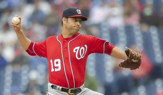Washington Nationals starting pitcher Anibal Sanchez (19) throws during a baseball game against the Philadelphia Phillies, Sunday, May 5, 2019, in Philadelphia. (AP Photo/Laurence Kesterson) ** FILE **
