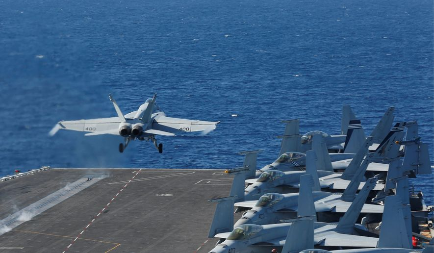 """In this May 3, 2019, file photo released by the U.S. Navy, an F/A-18E Super Hornet from VFA 25 launches from the flight deck of the Nimitz-class aircraft carrier USS Abraham Lincoln. The U.S. is dispatching the USS Abraham Lincoln and other military resources to the Middle East following """"clear indications"""" that Iran and its proxy forces were preparing to possibly attack U.S. forces in the region, according to a defense official on May 5, 2019. (Mass Communication Specialist Seaman Michael Singley/US Navy via AP)"""